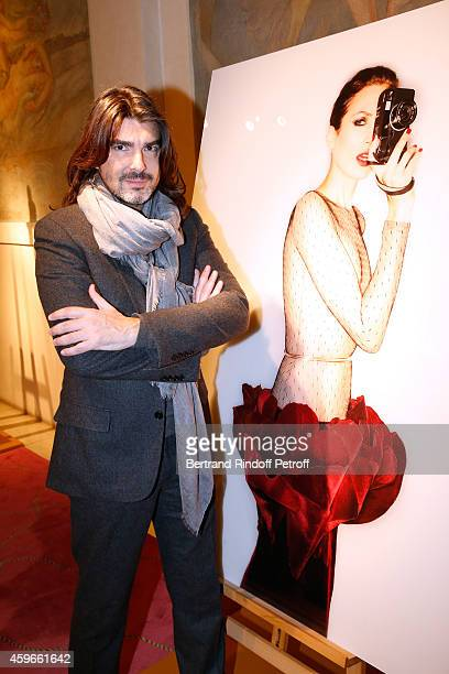Fashion Designer Stephane Rolland is pictured in front of his Christmas tree during the 19th Edition of 'Les Sapins de Noel des Createurs Designer's...