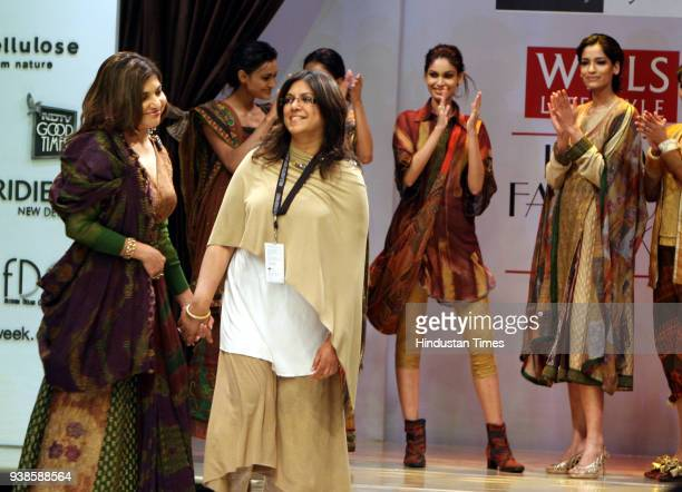 Fashion designer Sucheta V Merh along with singer Alka Yagnik after showcasing her creations at Wills Lifestyle India Fashion Week 2008 in New Delhi