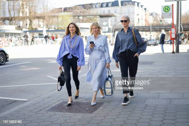 Fashion designer Sue Giers wearing black leggings by Norba, a black bag with gold details by Chanel, black sandals by Prada, a blue and white striped...