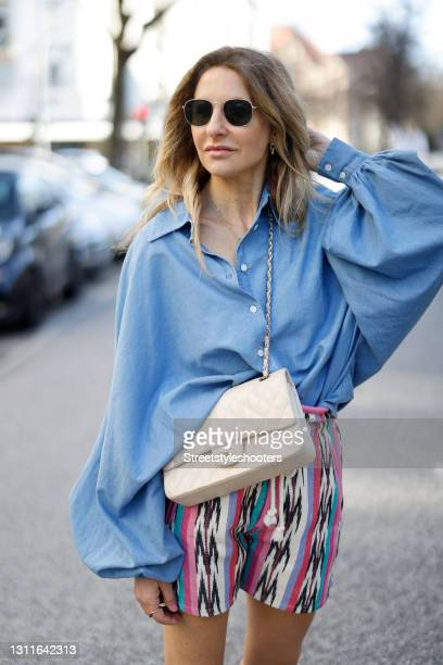 """Fashion designer Sue Giers wearing grey and cream color sneaker by Balenciaga, a taupe color maxi skirt by SoSUE, a white hoodie by SoSUE""""nduring a..."""