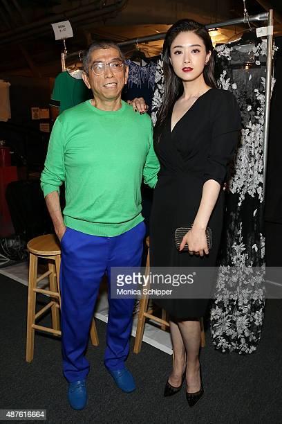 Fashion designer Tadashi Shoji and Actress Tian Hai Rong prepare backstage at the Tadashi Shoji fashion show during Spring 2016 New York Fashion Week...