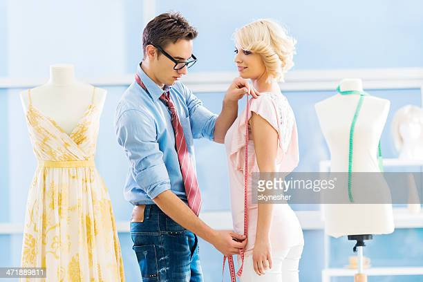 Fashion designer taking measurements.