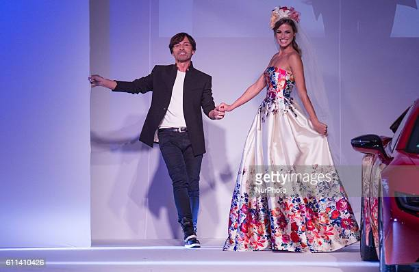 Fashion designer Tamas Naray acknowledges the applause of the audience after Tamas Naray Fashion Show as part of BMW Wallis New Saloon Grand Opening...