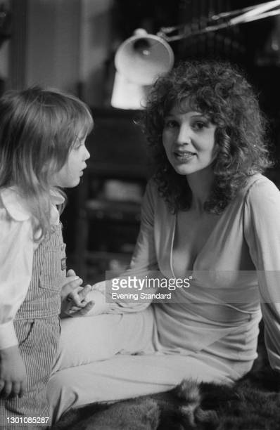 Fashion designer Tanya Sarne, wife of actor and singer Mike Sarne and later the founder of fashion label Ghost, with her daughter Claudia, UK, March...