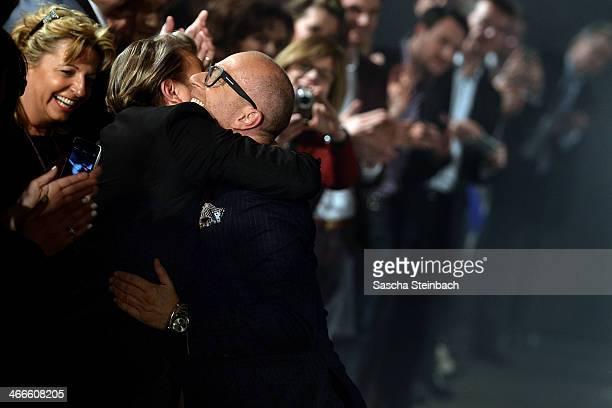 Fashion designer Thomas Rath hugs his husband Sandro Rath after the Thomas Rath fashion show during Platform Fashion Dusseldorf on February 2, 2014...