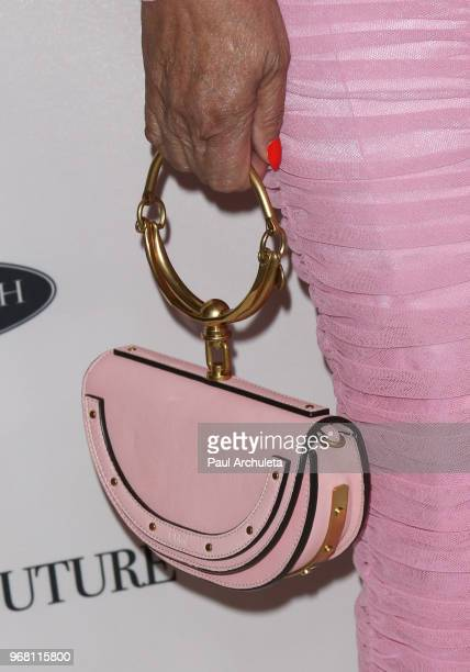 Fashion Designer Tina Knowles handbag detail attends the Ladylike Foundation's 2018 Annual Women Of Excellence Scholarship Luncheon at The Beverly...