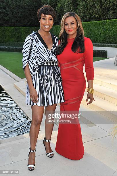 Fashion designer Tina Knowles Lawson and Ebony CEO Desiree Rogers attend a Champagne Toast in honor of July cover star Tina Knowles Lawson hosted by...