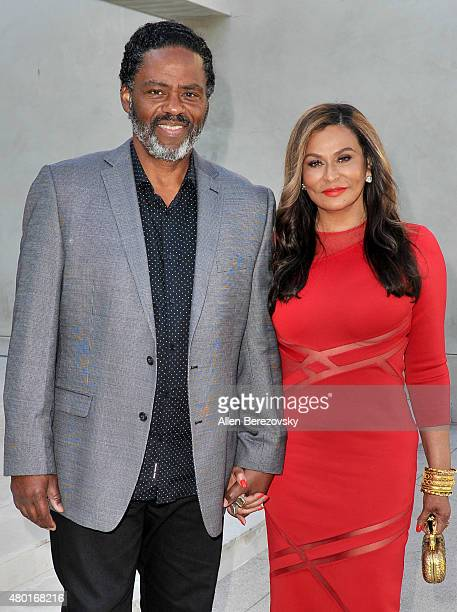 Fashion designer Tina Knowles Lawson and husband Richard Lawson attend a Champagne Toast in honor of July cover star Tina Knowles Lawson hosted by...