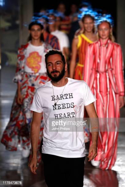 Fashion designer Tiziano Guardini acknowledge the audience at the Tiziano Guardini show during the Milan Fashion Week Spring/Summer 2020 on September...