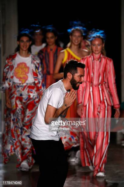 Fashion designer Tiziano Guardini and models acknowledge the audience at the Tiziano Guardini show during the Milan Fashion Week Spring/Summer 2020...
