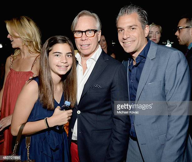 Fashion designer Tommy Hilfiger agent Christian Carino and guest attend the Zooey Deschanel for Tommy Hilfiger Collection launch event at The London...