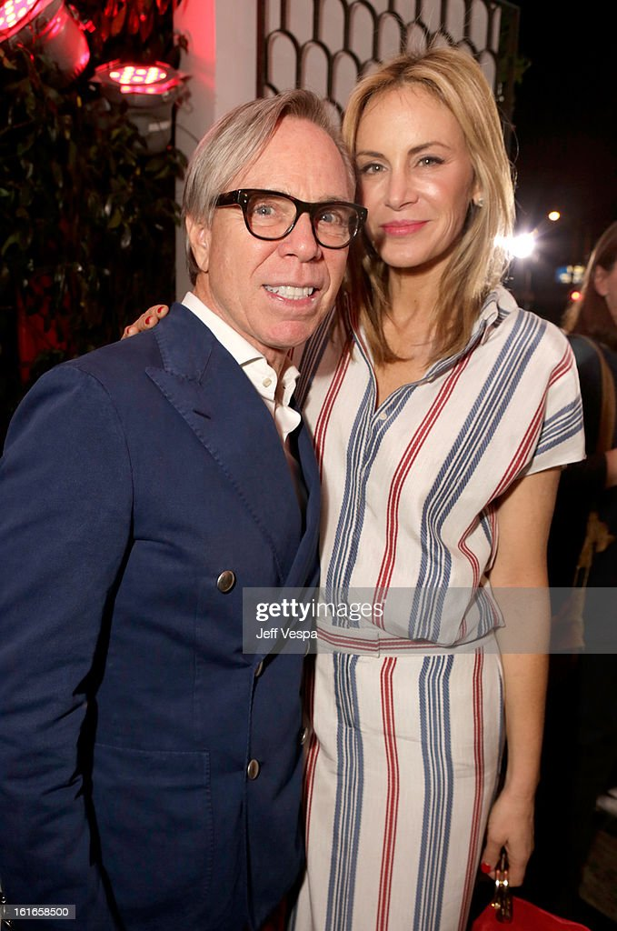 Fashion designer Tommy Hilfiger and Dee Hilfiger attend the Topshop Topman LA Opening Party at Cecconi's West Hollywood on February 13, 2013 in Los Angeles, California.