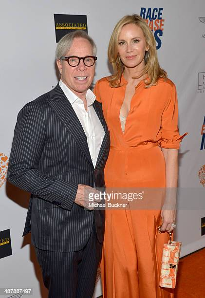 Fashion designer Tommy Hilfiger and Dee Ocleppo attends the 21st annual Race to Erase MS at the Hyatt Regency Century Plaza on May 2, 2014 in Century...