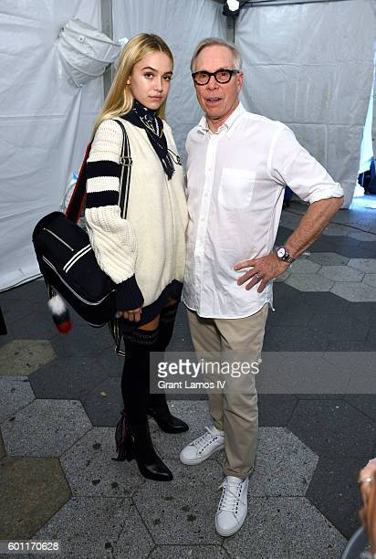 Fashion designer Tommy Hilfiger poses with a model backstage at the #TOMMYNOW Women's Fashion Show during New York Fashion Week at Pier 16 on...