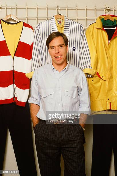 Fashion designer Tommy Hilfiger poses with his designs in his studio New York September 10 1987