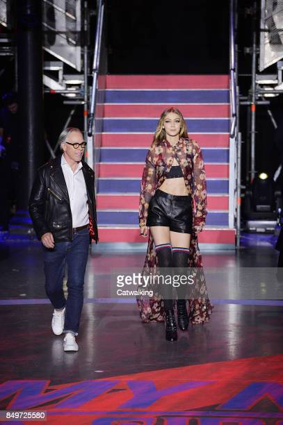 Fashion designer Tommy Hilfiger walks the runway with supermodel Gigi Hadid at the TOMMYNOW by Tommy Hilfiger Fall Winter 2017 fashion show during...