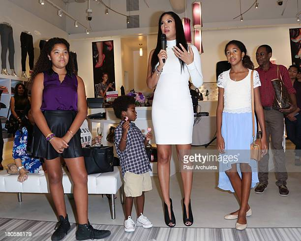 Fashion Designer / TV Personality Kimora Lee Simmons and her kids Ming Lee Simmons Kenzo Hounsou and Aoki Lee Simmons attends the JustFab boutique...