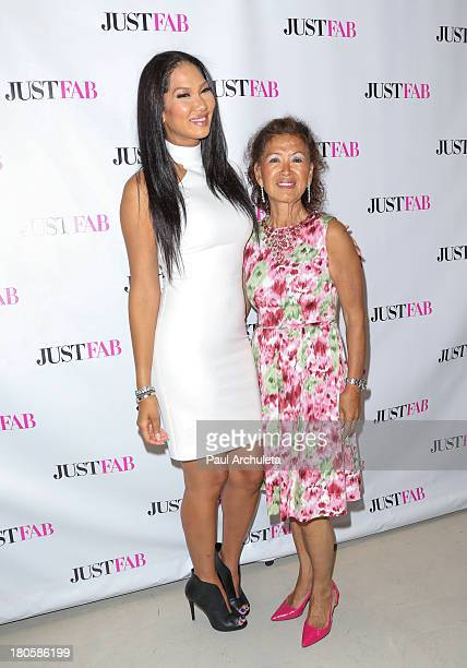 Fashion Designer / TV Personality Kimora Lee Simmons and her Mother Joanne Kyoko Perkins attends the JustFab boutique flagship store grand opening at...