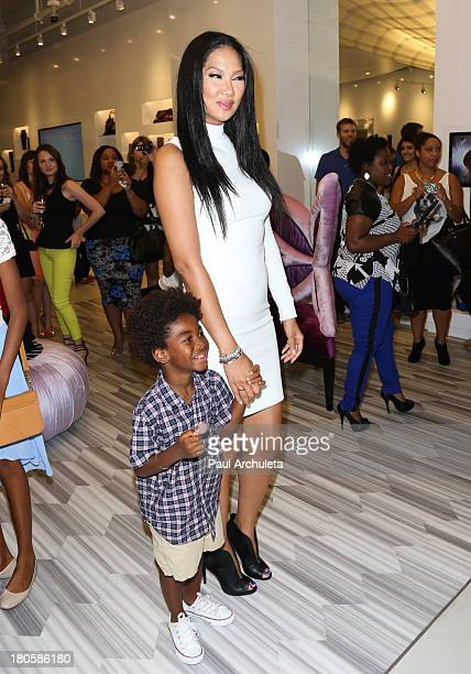 Fashion Designer / TV Personality Kimora Lee Simmons and her son Kenzo Hounsou attend the JustFab boutique flagship store grand opening at JustFab...