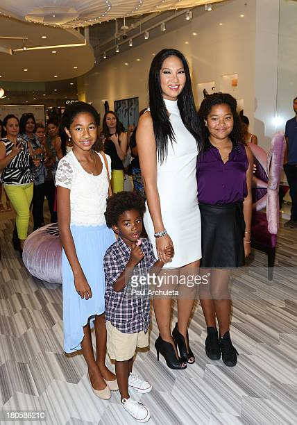 Fashion Designer / TV Personality Kimora Lee Simmons with her kids Aoki Lee Simmons Kenzo Hounsou and Ming Lee Simmons attends the JustFab boutique...