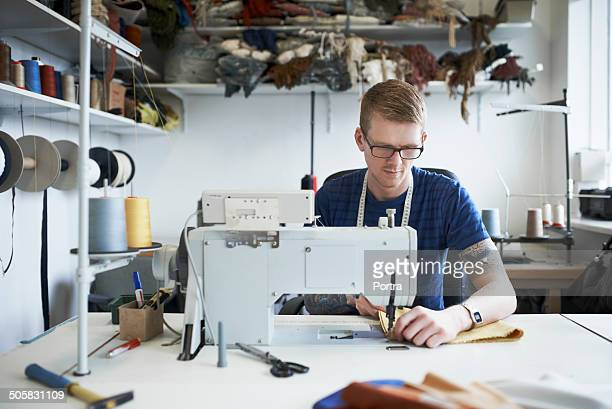 fashion designer using sewing machine - fashion designer stock photos and pictures