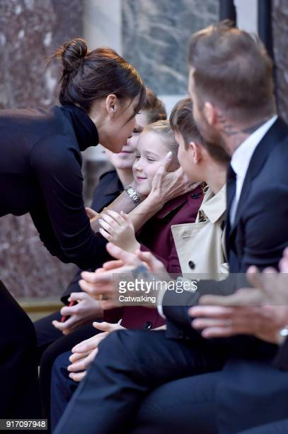 Fashion designer Victoria Beckham kisses her daughter Harper while her husband David Beckham looks on at the Victoria Beckham Autumn Winter 2018...