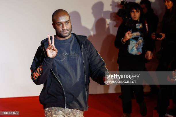 US fashion designer Virgil Abloh acknowledges applause following the presentation of the men's Fall/Winter 2018/2019 collection he designed for Off...