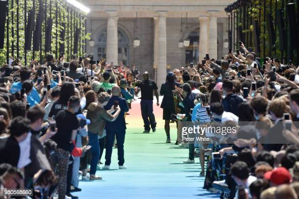 Fashion designer Virgil Abloh acknowledges the audience on the runway during the Louis Vuitton Menswear Spring/Summer 2019 show as part of Paris...