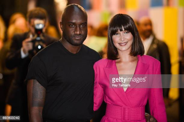 Fashion designer Virgil Abloh and model Bella Hadid enter the CFDA Fashion Awards at Hammerstein Ballroom on June 5 2017 in New York City