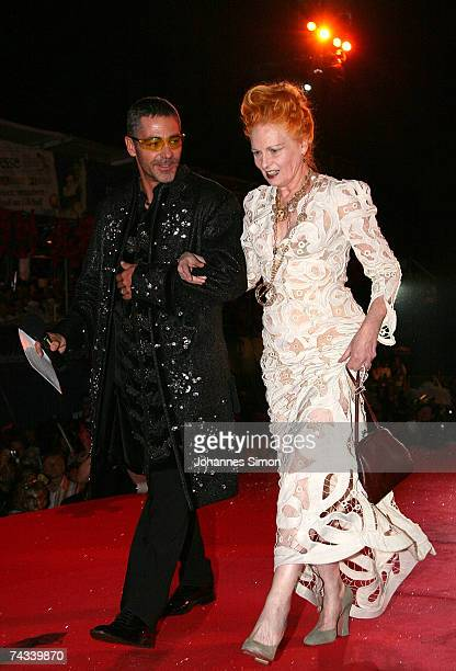 Fashion designer Vivienne Westwood arrives on stage with TV presenter Christian Clerici during the Vienna Life Ball on May 26 in Vienna Austria The...