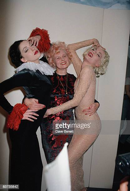 Fashion designer Vivienne Westwood with two models during London Fashion Week March 1992