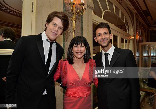 Fashion designer Wes Gordon from left honorary chair Judy Dimon and Paul Arnhold stand for a photograph at the Ballet Hispanico gala in New York US...