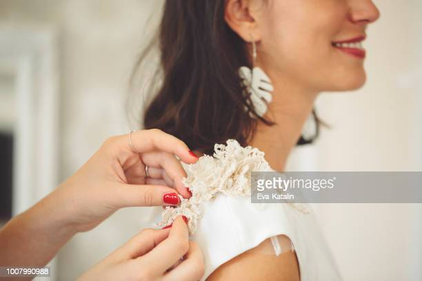 fashion designer with her client - wedding dress stock pictures, royalty-free photos & images
