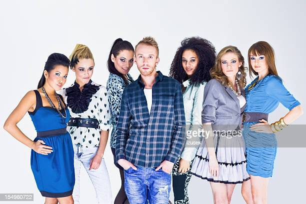 Fashion designer with his models