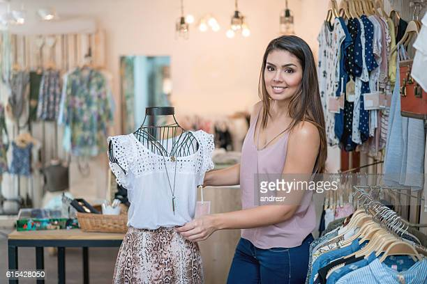 Fashion designer working at a clothing store