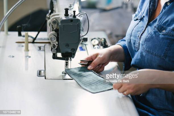 fashion designer working in her studio. - leather purse stock pictures, royalty-free photos & images