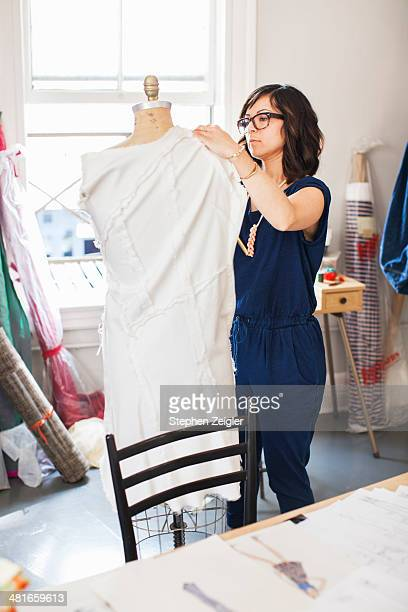 fashion designer working in her studio - fashion collection stock pictures, royalty-free photos & images
