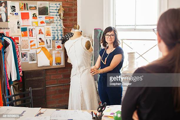 fashion designer working in studio - fashion collection stock pictures, royalty-free photos & images