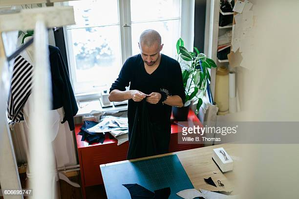 Fashion Designer working with Fabric