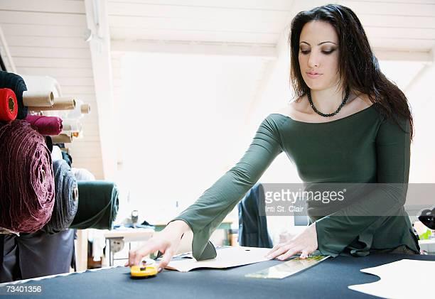 Fashion designer working with pattern in studio