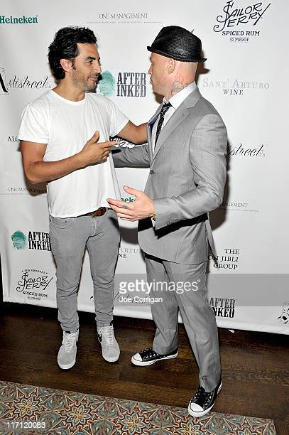 Fashion designer Yigal Azrouel and tattoo artist/TV personality Ami James attends the grand opening Wooster Street Social Club on June 22 2011 in New...