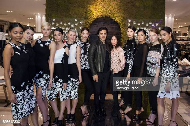 Fashion designer Yigal Azrouel and Vice President of Macy's 'Fashion Office Women's Ready to Wear' Stephanie Muehlhausen pose with runway models...