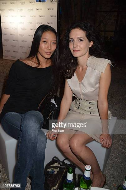 Fashion designer Yiqin Yin and Chloe Lambert attend the Peroni Nastro Azzuro Beer Cocktail Party at the Italian Embassy on September 29 2011 Paris...