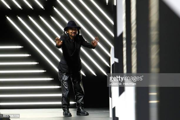 Fashion designer Yohji Yamamoto acknowledges the applause of the audience after the Y-3 Menswear Fall/Winter 2014-2015 Show as part of Paris Fashion...