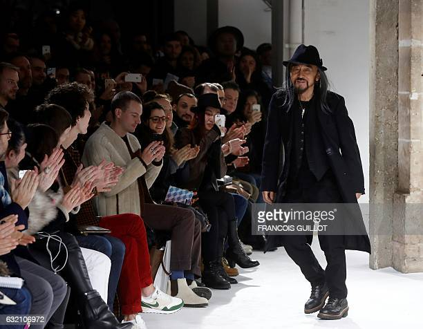 Fashion designer Yohji Yamamoto acknowledges the public following the presentation of his creations during men's Fashion Week for the Fall/Winter...