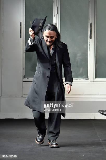Fashion designer Yohji Yamamoto walks the runway during the Yohji Yamamoto Menswear Spring/Summer 2019 fashion show as part of Paris Fashion Week on...