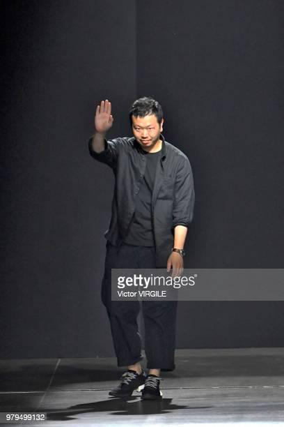 Fashion designer Yosuke Aizawa walks the runway at the Hunting World fashion show during Milan Men's Fashion Week Spring/Summer 2019 on June 18 2018...