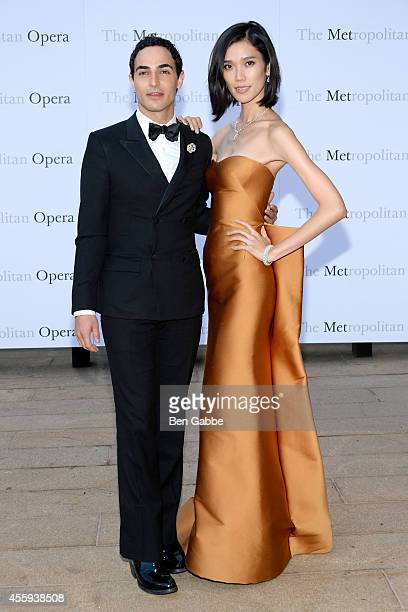 Fashion designer Zac Posen and model Tao Okamoto attend the Metropolitan Opera Season Opening at The Metropolitan Opera House on September 22 2014 in...