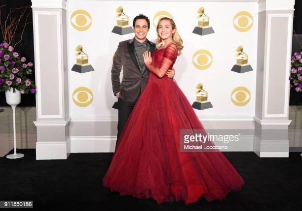 fashion-designer-zac-posen-and-recording-artist-miley-cyrus-pose-in-the-press-room-during-the