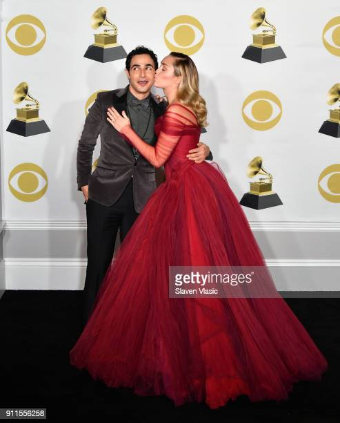 Fashion designer Zac Posen and recording artist Miley Cyrus pose in the press room during the 60th Annual GRAMMY Awards at Madison Square Garden on...
